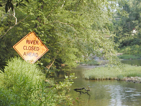River closed ahead Sign